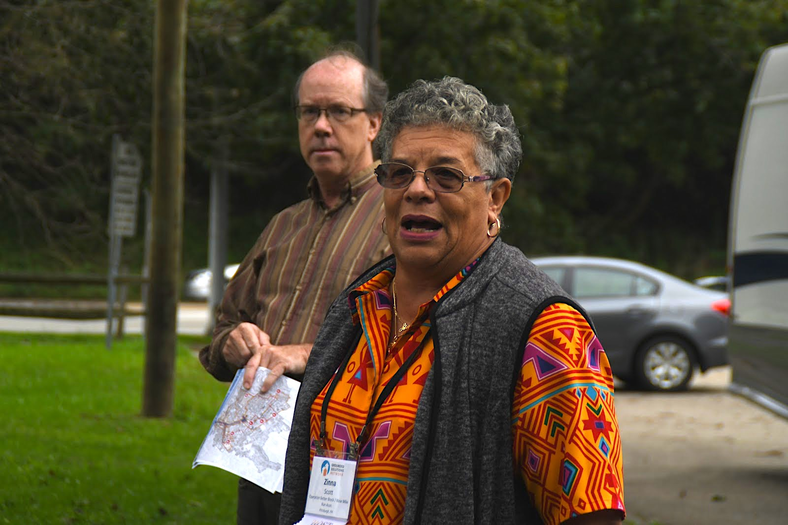 Zinna Scott and John Stephens welcome ALCOSAN staff and community tour goers at the Zone Five Police Station on Washington Boulevard
